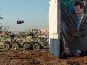 Russian armoured personnel carriers supporting Syrian government troops
