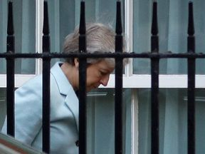Theresa May arrives at the back entrance of 10 Downing Street