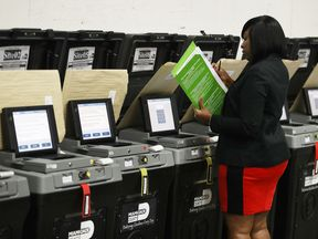 DORAL, FL - AUGUST 08: Andcherla Marcelin, a Miami-Dade election support specialists, checks voting machines for accuracy at the Miami-Dade Election Department headquarters on August 8, 2018 in Doral, Florida. The accuracy test includes setting up the equipment for transmitting and tabulating results. It is just one of several measures that are taken by Miami-Dade election department during the preparation for an election to ensure that voting equipment is ready for use. (Photo by Joe Raedle/Get