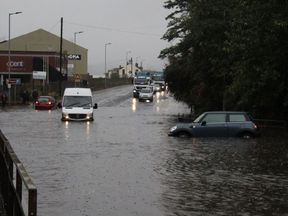 A flooded road between Sheffield and Rotherham