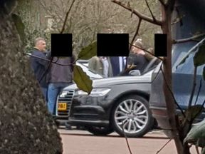 GRU officers being apprehended by Dutch intelligence officers near the headquarters of the OPCW in The Hague