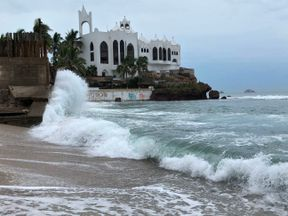 Waves hitting the shore in Mazatlan in Mexico ahead of the arrival of Hurricane Willa