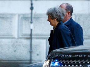 Theresa May arrives at Downing Street
