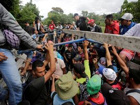 Honduran migrants board trucks sending them back to Honduras after they crossed the border into Guatemala illegally in their bid to reach the US