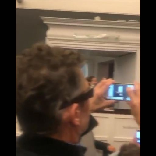 Who is the mystery man filming at Banksy auction?