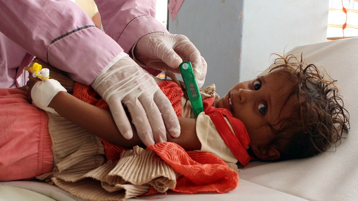 A Yemeni child suspected of being infected with cholera is checked in the northern district of Abs last year