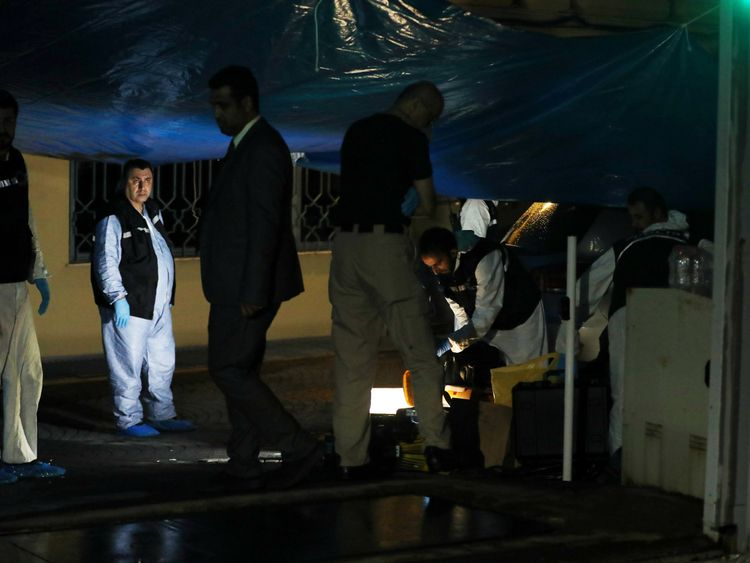 Forensics officers searching the Saudi consul's backyard