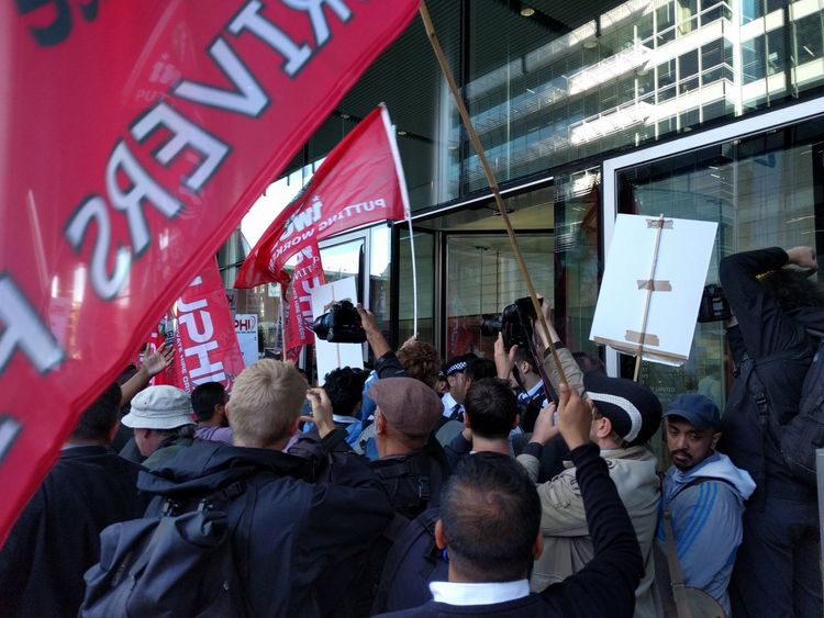 Protesters on strike outside of Uber's office