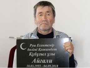 Aigali Supygaliev posed with his gravestone after re-emerging