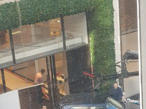 The car reversed into the luxury store. Pic: @BeckyLauder