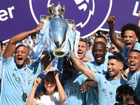 Manchester City's players celebrate after winning the Premier League in May