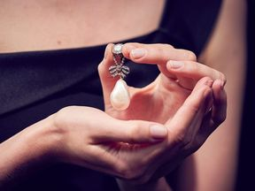 Marie Antoinette's pearl pendant was originally on a three- strand pear necklace