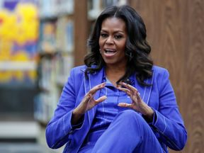 Former first lady Michelle Obama begins her book tour with a stop at the Whitney M. Young Magnet High...