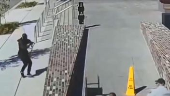 Police in Sydney are asking for any information about the robbery seen in this CCTV
