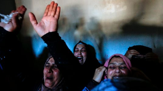 Relatives of Khaled Qwaider, one of the seven Palestinians killed during an Israeli special forces operation in the Gaza Strip, mourn during his funeral on November 12, 2018