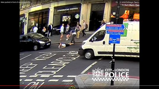 CCTV shows the man being shoved into the path of an oncoming taxi