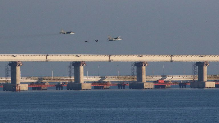 Russian jet fighters fly over a bridge connecting Russia with the Crimean peninsula