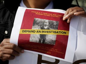 A woman holds a picture of Jakelin Caal, a 7-year-old Guatemalan girl who died in Us custody after crossing illegally from Mexico to the US