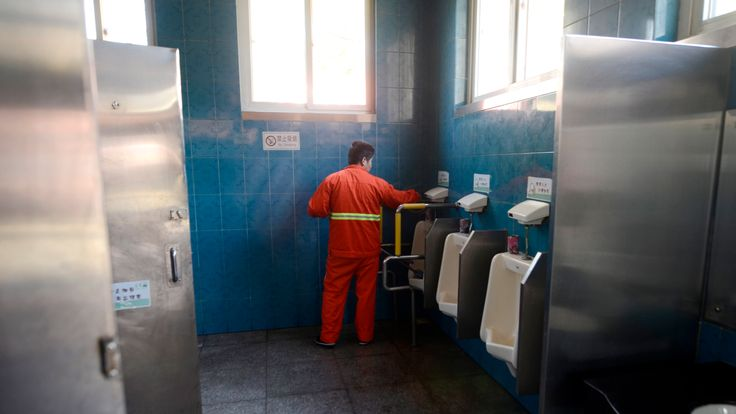 Urinals in Beijing, which are a far more modern form of toilet than parts of China are used to