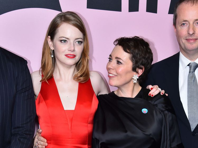 Emma Stone (left) with co-star Colman