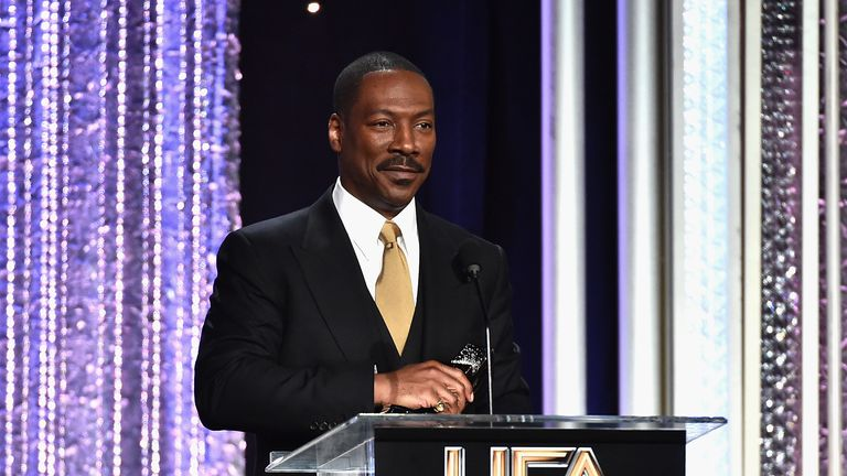 """Actor Eddie Murphy, recipient of the """"Hollywood Career Achievement Award"""", speaks onstage during the 20th Annual Hollywood Film Awards on November 6, 2016 in Beverly Hills, California. (Photo by Alberto E. Rodriguez/Getty Images)"""