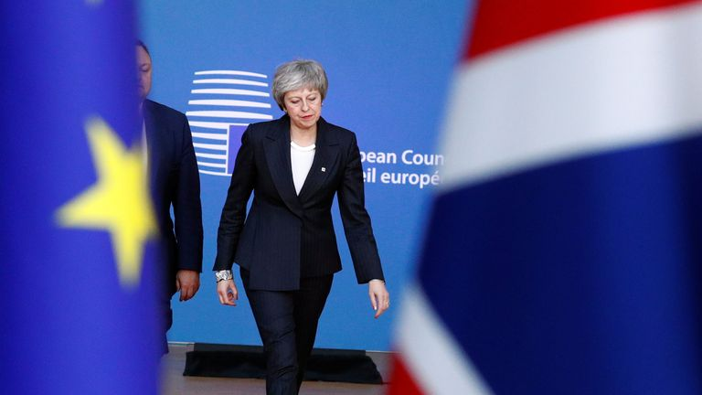 Theresa May arrives at a European Union leaders summit in Brussels