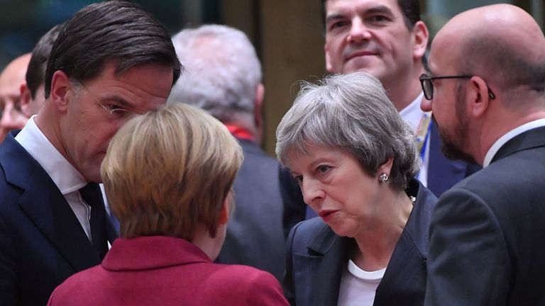 Theresa May speaking with EU leaders at the summit in Brussels