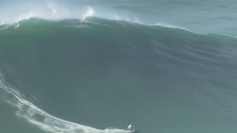 Surfers tackle giant waves off the coast of Portugal