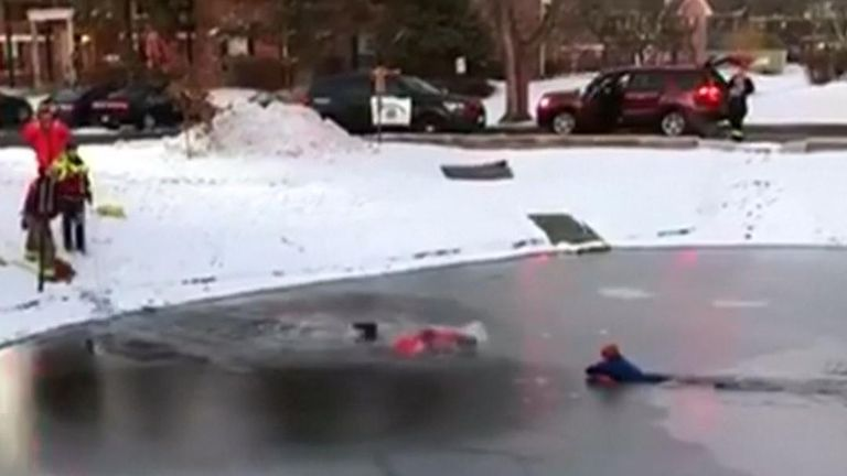 11-year-old boy is rescued from centre of icy pond in Illinois