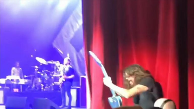 Security guards help Dave Grohl get back on stage. Pic: Instagram/i_play_with_cars