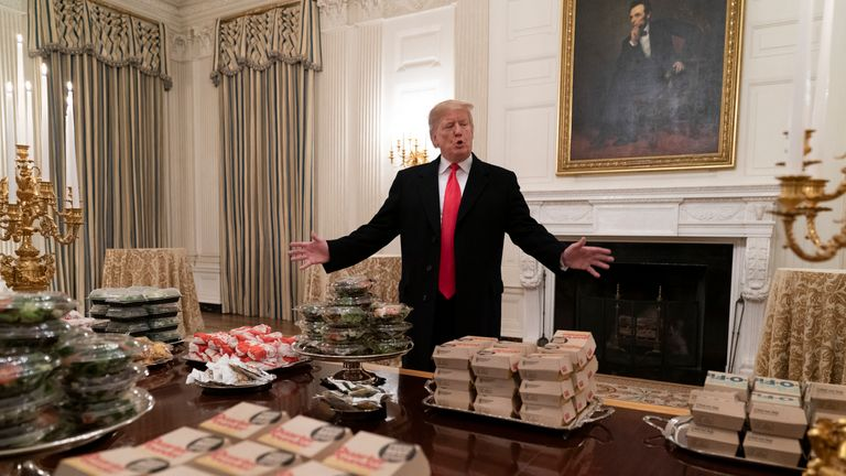 U.S President Donald Trump presents fast food to be served to the Clemson Tigers football team to celebrate their Championship at the White House on January 14, 2019 in Washington, DC