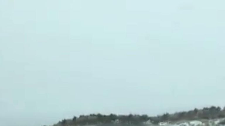 Hundreds of elk galloped across a snowy Washington road.