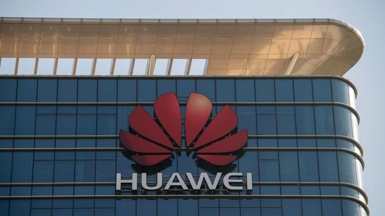 The Huawei logo is seen on a Huawei office building in Dongguan in Chinas southern Guangdong province on December 18, 2018. (Photo by Nicolas ASFOURI / AFP) (Photo credit should read NICOLAS ASFOURI/AFP/Getty Images)