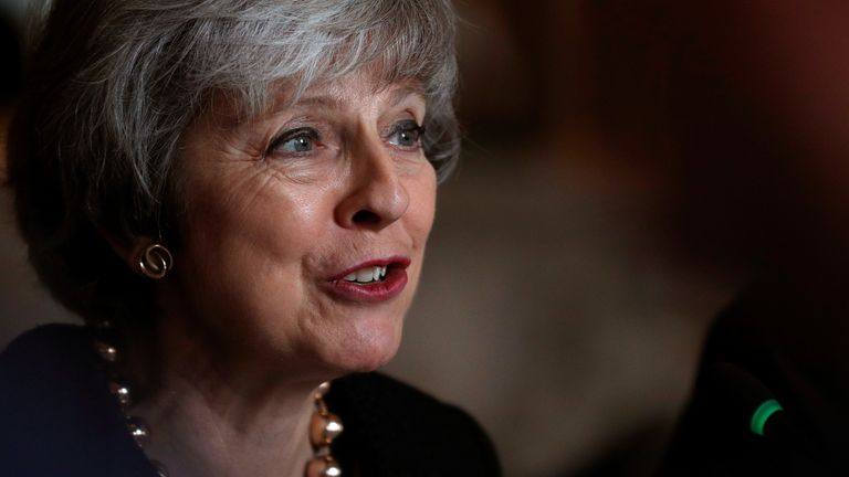Britain's Prime Minister Theresa May sits with members of her cabinet during the UK-Poland Inter-Governmental Consultations at Lancaster House in London